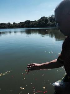 Joe Madison Puts Flowers in Bay in Memory of Julian Bond